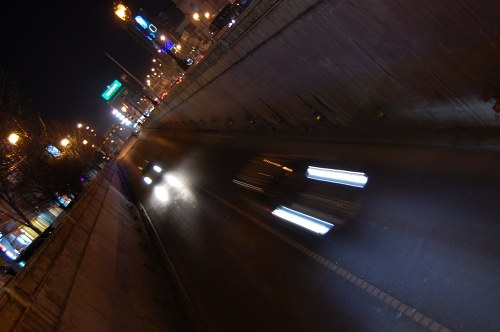 Cars entering a tunnel at night