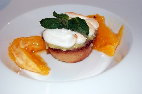 Desert with orange cream and mint on a plate