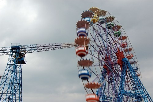 Ferris wheel in amusement park and crane