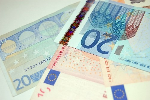 Variety of euro banknotes on a table