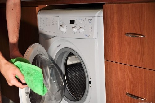 Adding clothes in the washing machine