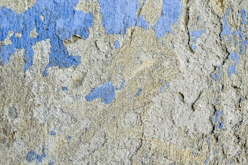 Blue paint over concrete texture