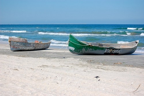 Boats on a empty beach