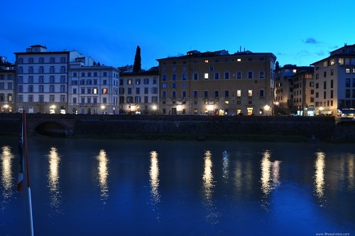 Building on Arno river banks at night