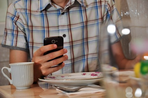 Free photos: Checking email on mobile phone at breakfast