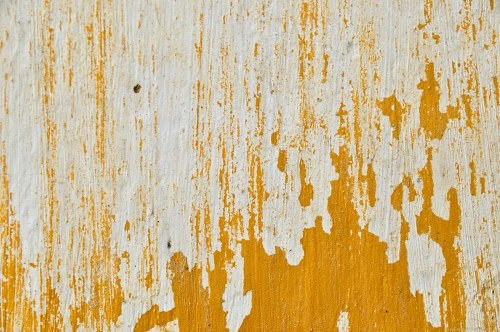 Flaked yellow paint