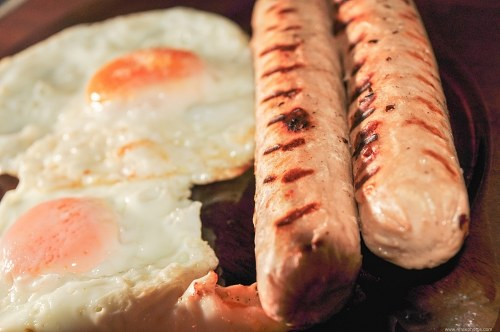 Grilled sausages and eggs