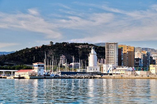 Free photos: Malaga lighthouse from sea at sunset