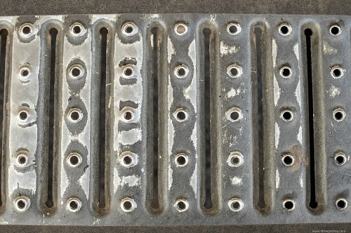 Metal grating with holes