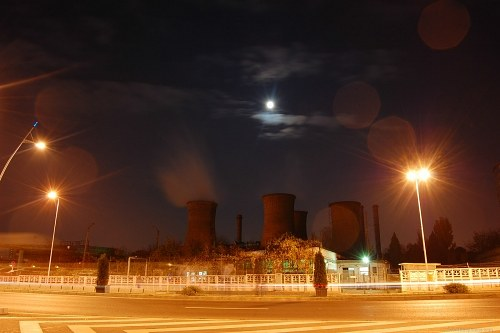 Moon over a industrial area long exposure