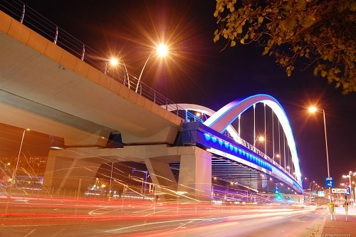Moving traffic under a bridge at night