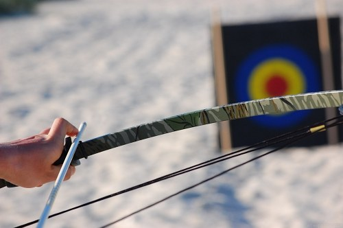 Free photos: Preparing to  shoot  a bow