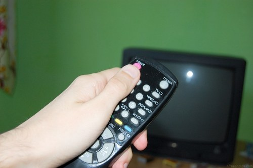 Pressing power button on a tv remote control