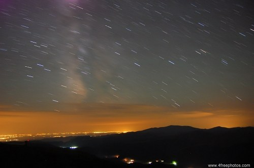 Stars trailing over city