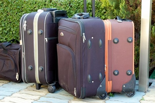 Suitcases in front of a hotel