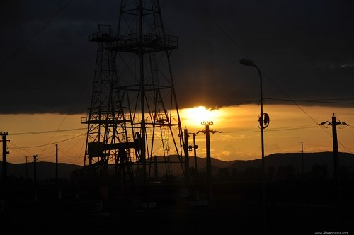 Sunset over oil field