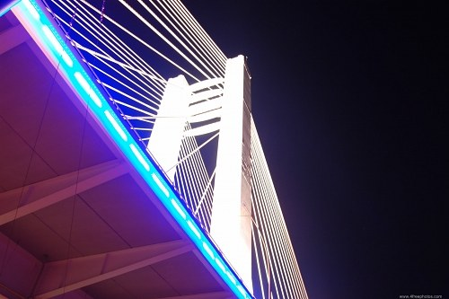 Tall bridge pylon at night