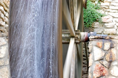 Water mill wheel turning