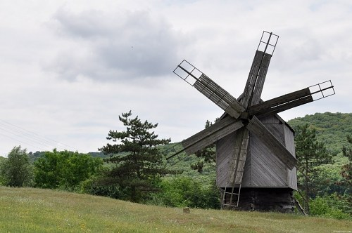 Wind mill next to forest