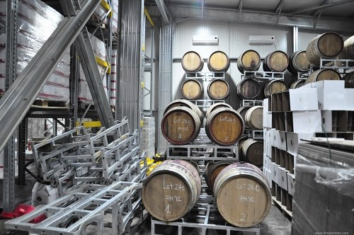 Wine barrels in warehouse