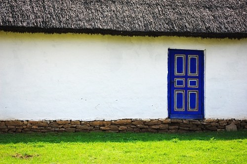 Blue door on white wall