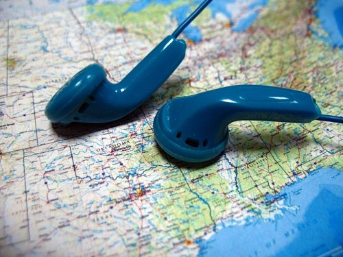 Blue headphones on map