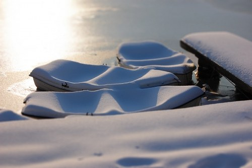 Boats covered in snow