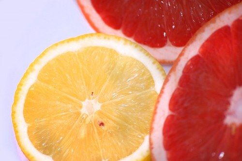 Lemon and grapefruit cut in half