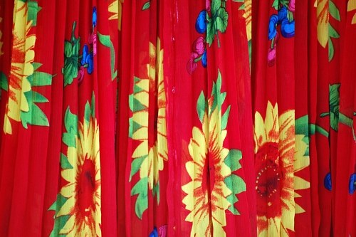 Red textile with yellow flowers