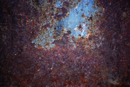 Rusty and etched paint