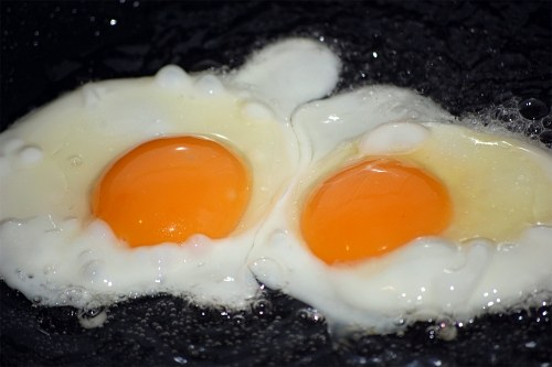 Twin eggs in pan